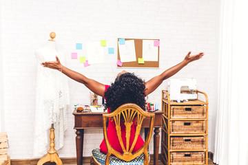 african american black woman fashion designer working at workshop studio