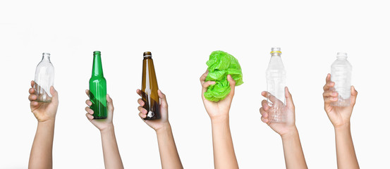 hand holding garbage of bottle glass and bottle plastic with plastic bag isolate on white background