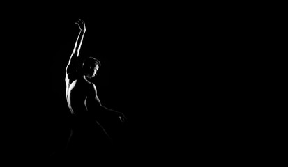 Black and white silhouette of male ballet dancer. Long monochrom horizontal image.