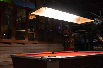 Vintage pool table in night club, pool snooker billiard concept background.