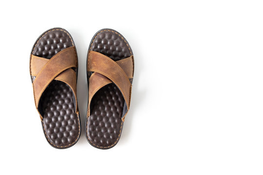Top view men sandals brown leather flip flop shoes isolated on white background