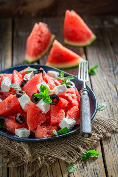 Sweet watermelon salad with feta cheese and black olives