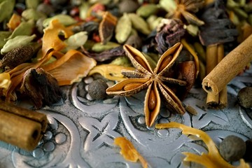 Mixed spices close up on old metal plate