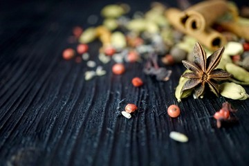 Mixed spices on dark wood. selective focus lots of copy space