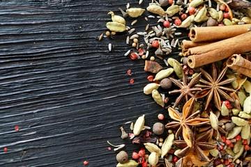 Spice mix on dark wood background