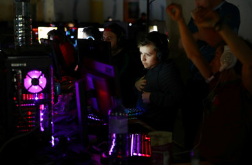 Gamers react as they play a tournament during the Electronic Sports Festival, Austria's largest LAN Party in Vienna