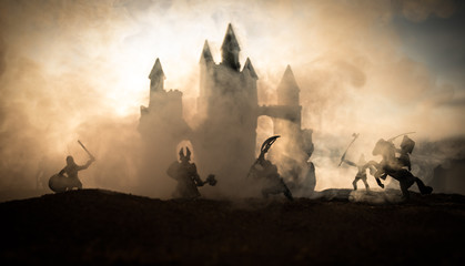 Medieval battle scene with cavalry and infantry. Silhouettes of figures as separate objects, fight between warriors on sunset foggy background. Wall mural
