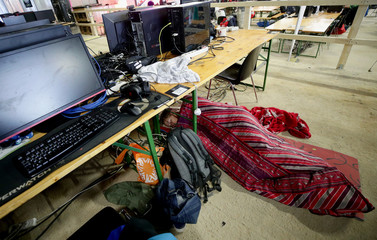 A gamer rests beneath a table during the Electronic Sports Festival, Austria's largest LAN Party in Vienna