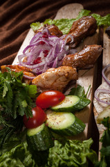 Canvas Prints Meat Grilled meat on a wooden Board with vegetables