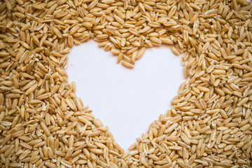 Oat grains  in the shape of a heart with a place for designers. The concept of love of oat