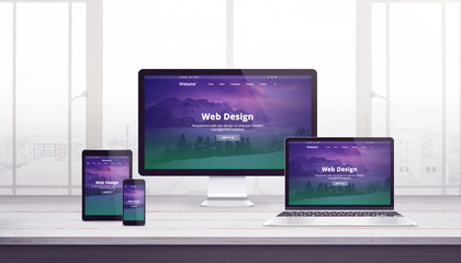 Wall Mural - Responsive web site concept on multiple devices. Work desk with window in background. Modern flat web design with purple green page concept.