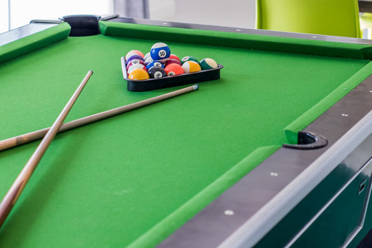 close up of pool ball on pool table