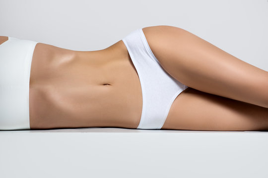 ideal shape of the female body. Woman in underwear with a beautiful figure lying