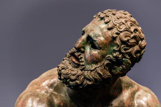 Detail of a face of an ancient roman bronze statue