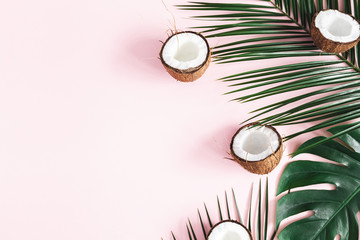 Summer composition. Tropical palm leaves, coconut onpastel pink background. Summer concept. Flat lay, top view, copy space