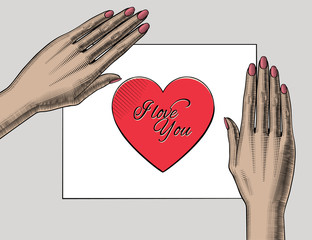 Woman's hand holding on the palm a red paper heart with I love You lettering. Retro style valentine greeting card design. Vintage engraving stylized drawing. .Vector illustration