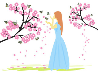 A woman in a blue dress under a tree with pink flowers has a white background. Fototapete