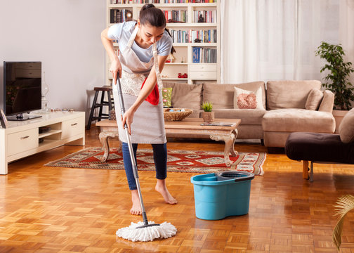 woman cleaning home daily routine