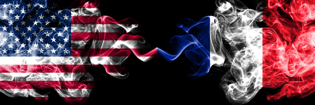 United States of America vs France, French smoky mystic flags placed side by side. Thick colored silky smoke flags of America and France, French