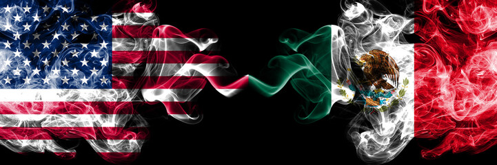 United States of America vs Mexico, Mexican smoky mystic flags placed side by side. Thick colored silky smoke flags of America and Mexico, Mexican