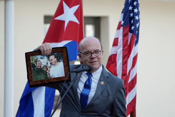 U.S. Congressman James Mcgovern shows a picture of him with late Cuban President Fidel Castro during an event at the Ernest Hemingway Museum in Havana