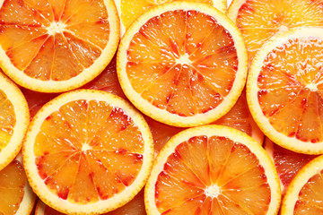 Wall Murals Slices of fruit Juicy blood orange slices as background, top view. Citrus fruit