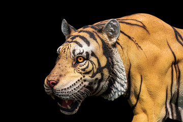 Tiger statue (with clipping path) isolated on a black background
