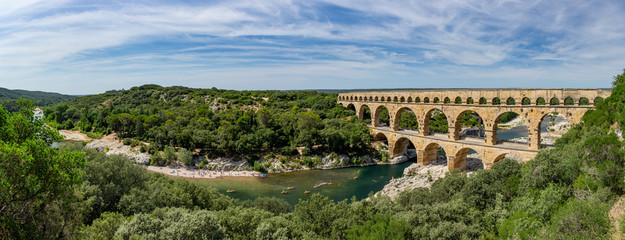 Obraz Panoramic view of the magnificent three tiered Pont Du Gard aqueduct was constructed by Roman engineers in the 1st century AD in the south of France - fototapety do salonu
