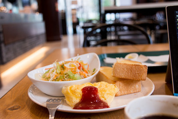 Omelette/salad/bread and coffee - moment of breakfast at cafe in the morning in Tokyo, Japan