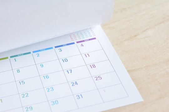 Calendar on a wooden background