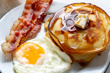 American breakfast with egg, pancake and bacon