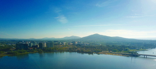 Panoramic view of Canberra (Australia) in daytime, featuring Lake Burley Griffin, Molonglo River, Mount Ainslie.