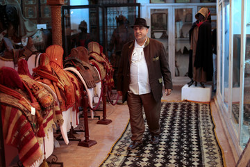 Mohamed Abdelilah Belghazi founder of a museum that collects and safeguards relics showcasing MoroccoÕs religious diversity, poses for a photograph in the museum in Kenitra city near Rabat