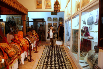 Mohamed Abdelilah Belghazi founder of a museum that collects and safeguards relics showcasing MoroccoÕs religious diversity, poses for a photograph in the museum in Kenitra city near Rabat,