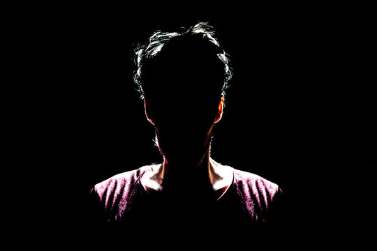 silhouette of man in dark place, anonymous backlit contour a