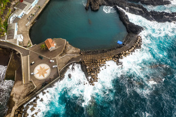 Wall Mural - Aerial view of pier near Seixal village, Madeira island, Portugal. Summer travel background.