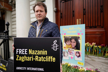 Richard Ratcliffe, husband of British-Iranian dual national Nazanin Zaghari-Ratcliffe, poses for a photograph after delivering a Mother's Day card and flowers to the Iranian Embassy in London