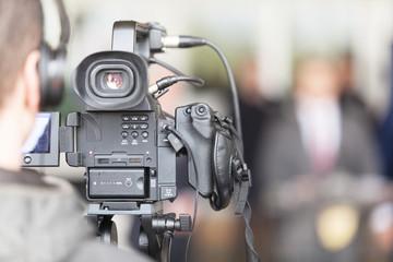 Cameraman working at press conference