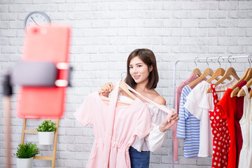woman sell clothes in livestreaming