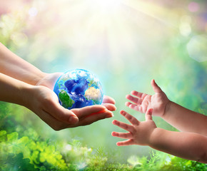 Wall Mural - Mother Give Blue Earth In Daughter Hands - elements of this image furnished by NASA - 3d Rendering
