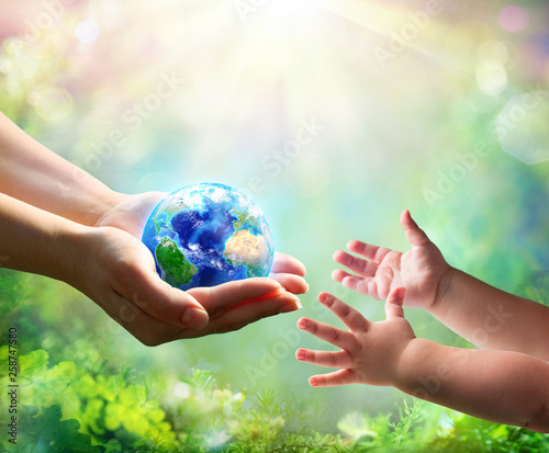 Wall mural Mother Give Blue Earth In Daughter Hands - elements of this image furnished by NASA - 3d Rendering