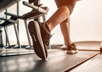 Close up on shoe,Women running in a gym on a treadmill.exercising concept.fitness and healthy lifestyle