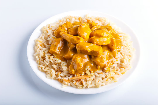 Rice with chicken curry sauce with cashew isolated on white background.