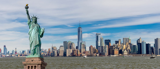 Panorama view of The Statue of Liberty with One World Trade Center and Manhattan downtown sky...