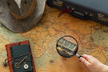preparation for the trip. Old map with marked treasure and vintage travel equipment