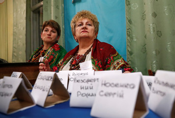 Members of a local electoral commission count votes following Ukraine's presidential election in Rohatyn