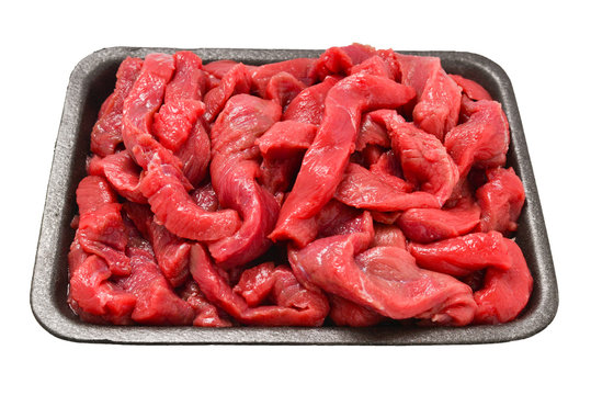 Raw veal slices in container isolated on white background.