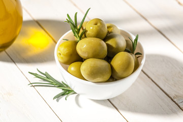 Bowl with canned olives on white background