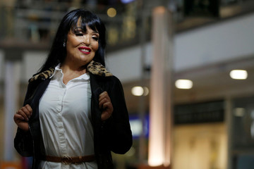 """Patricia Espitia, survivor of an acid attack, poses for a photo on the runway during the fashion show """"Women who are reborn"""" in Bogota"""