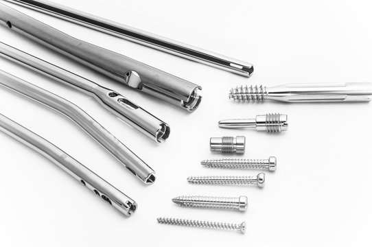 Screws and pegs made of stainless steel isolated on the white background